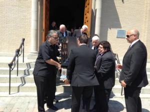 Pallbearers carry Joseph Del Grosso's casket out of St. Lucy's Church