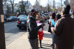 Hassan Manning, president of the Maple Avenue School PTA, hands out petitions