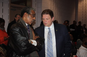 State Sen. Ronald Rice and NJEA President Wendell Steinhauer confer at last night's school board meeting