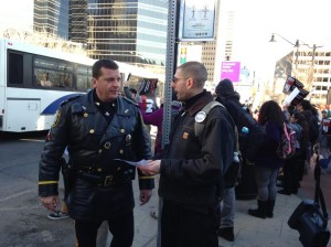Branden Rippy discusses protest plans with Lt. Robert Sarappa
