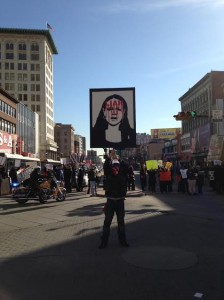 A protester holds an anti-Anderson sign at Broad and Market.