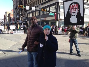 Newark Student Union leader Kristin Towkaniuk addresses demonstrators at Broad and Market