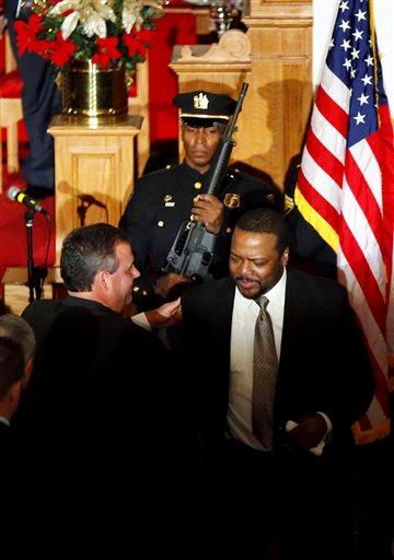 Christie hugs Rev. Carter