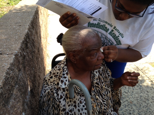 Deseret Segrua, 16,  brushes tears away from the eyes of her grandmother, Deseret Richardson, 83.