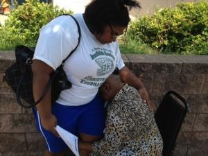 "Deseret Segura, 16, comforts her sobbing grandmother, Deseret Richardson, 83, outside the ""enrollment center"" in Newark."