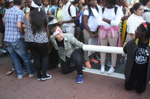 Kristin Towkaniuk, president of the Newark Students Union, forms the chain to block Broad Street