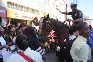 Students hold the line against efforts by mounted policeman to break through
