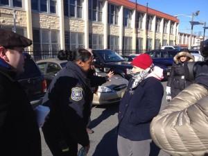 Speical officer Twanda Jones tries to persuade NSU president Kristin Towkaniuk to leave parking lot