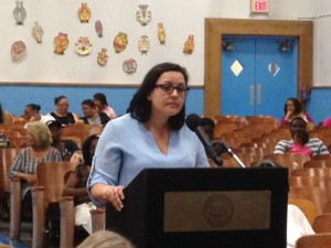 Vanessa Rodriguez at school board meeting--whosever fault paying Tiffy Hardrick was, it wasn't Cami's