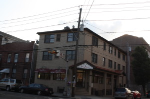 The corner of Pacific and East Kinney streets. The building to the left is the Ferreira home--the building to the right is the Oliver Street School.