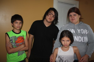 Isabel Troche and three of her children--William, Anthony, and Nashley. None have started school yet