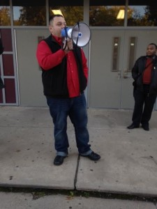 Roberto Cabanes, who helped organize the Newark Student Union, speaks to supporters outside University High School.