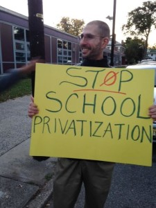 Branden Rippey, a leader of a dissident group within the Newark Teachers Union, demonstrates outside Univesity High School.