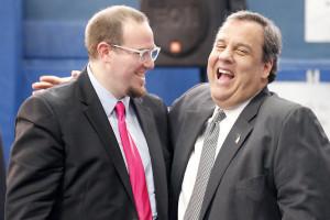 Christie shares a laugh with Andrew Schaefer, principal of NorthStar Alexander (NJ.COM photo)
