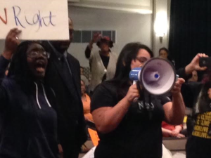 Newark Student Union members demonstrate at the board meeting