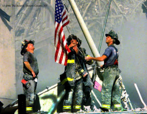 Tom Franklin (The Record) took this iconic picture of a REAL flag raising over Ground Zero