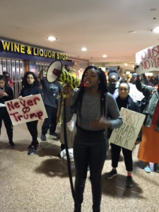 Halima Stewart, a Rutgers Newark student, speaks at rally at Newark Penn Station.